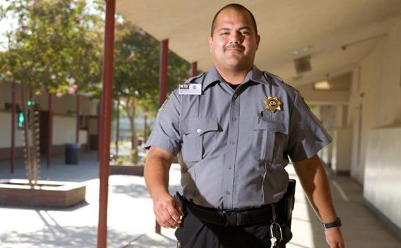 Guard Walking Through School Halls